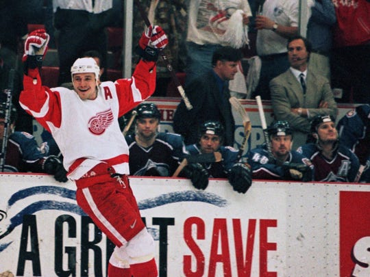 Detroit Red Wings' Sergei Federov, left, skates past the Colorado Avalanche bench after scoring the Red Wings second goal in Game 6 of the Western Conference finals series at Joe Louis Arena in Detroit, Monday, May 26, 1997.
