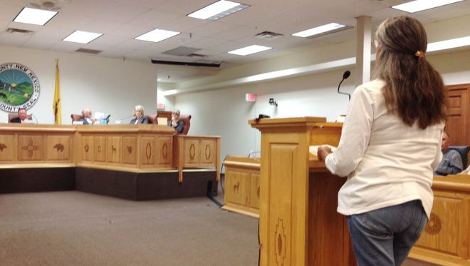 Candace Lee, president of Grant County SNAP, talks about the group's spay/neuter program at Thursday's County Commissioners meeting in Silver City.