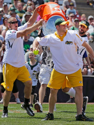 Jordy Nelson, left and Aaron Rodgers dump water on