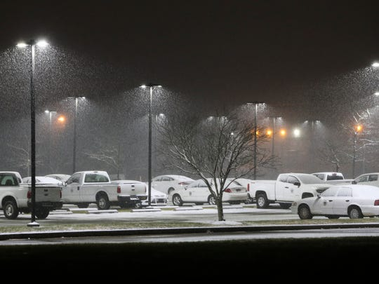 County vehicles are coated in snow at the New Castle County offices on commons Boulevard outside New Castle late Wednesday evening.