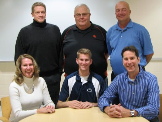 Central York's Royce Clemens signs to play volleyball at Penn State. Top from left is  coach Todd Goodling, coach Brad Livingston, athletic director Marty Trimmer. Bottom from left is Chris Clemens, Royce Clemens, Matt Clemens.