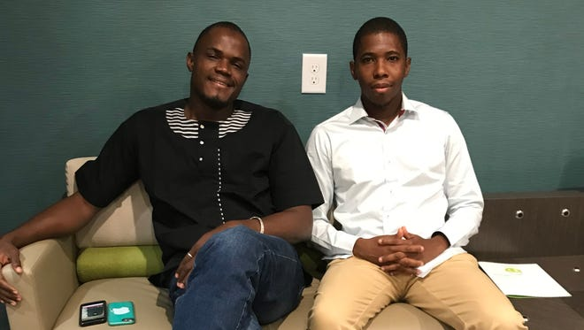 Lancinet Sangare, left, and Fousseyni Maiga, visiting journalists from Mali.