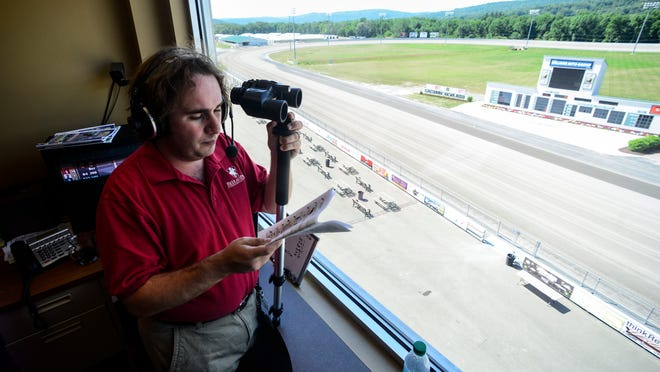 James Witherite announcer at Tioga Downs prepares his voice for Friday night's racing on July 11. He is in his first full season as track announcer at Tioga Downs
