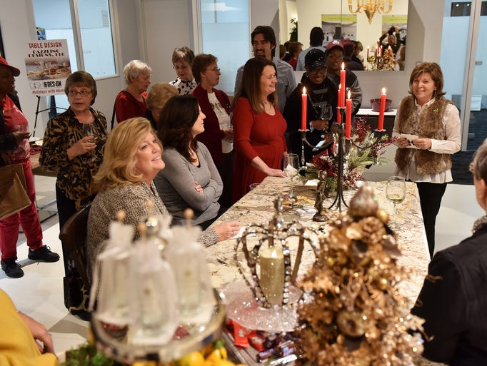 Donna Brown, right, of Dazzling Designs, talks about