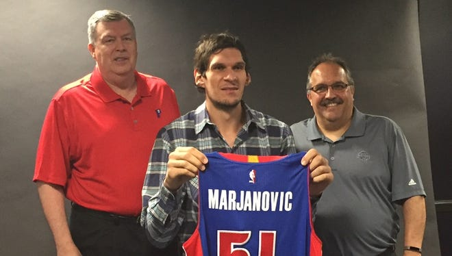 From left, Detroit Pistons assistant general manager Jeff Nix, new center Boban Marjanovic and president/coach Stan Van Gundy pose for a photo Tuesday, July 12, 2016, in Auburn Hills.