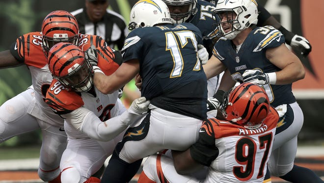 Bengals defensive tackle Geno Atkins (97) tallies a sack near the goal line in the fourth quarter of the NFL football game between the Cincinnati Bengals and the San Diego Chargers at Paul Brown Stadium on Sunday, Sept. 20, 2015. The Bengals won 24-19 in the home opener, improving to 2-0.