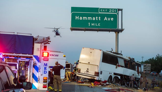 Rescue crews respond to the scene of a charter bus crash on northbound Highway 99 between Atwater and Livingston, Calif., Tuesday, Aug. 2, 2016.