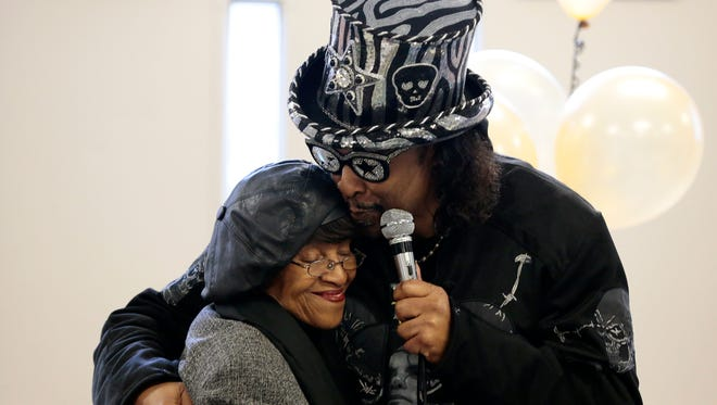 Former King Records recording artist Bootsy Collins thanks Evanston Community Council President Anzora Adkins (left) during a ceremony at the Evanston Recreation Center in the Evanston neighborhood of Cincinnati on Tuesday, Jan. 24, 2017. The city of Cincinnati honored musicians Collins, Philip Paul and Otis Williams by renaming three streets in their home neighborhoods for them.