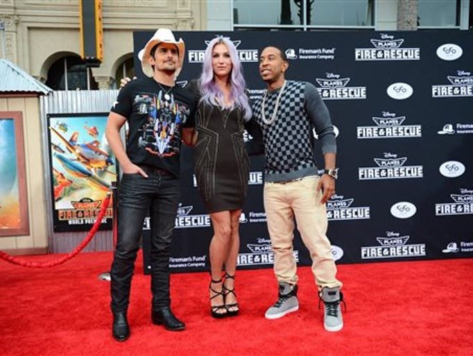 "From left, Brad Paisley, Kesha and Ludacris arrive at the world premiere of ""Planes: Fire And Rescue"" at El Capitan Theatre on Tuesday, July 15, 2014, in Los Angeles."