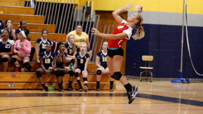 Rossview's Macy Maynard serves the ball across the net during the Lady Hawks volleyball match against rival Northeast Tuesday.