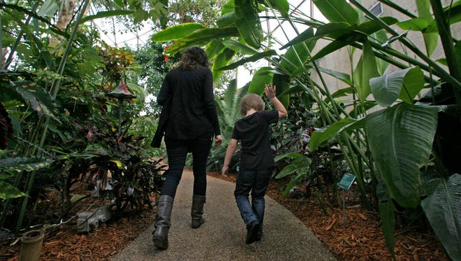 Tiffany Baird and her son Jackson stroll through the Greater Des Moines Botanical Garden.