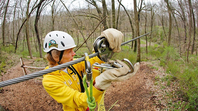 Guide Nick Tigges hooks up a rider at Sky Tours Zipline in Dubuque in 2014. Des Moines officials envision Ewing Park as the site for a high-ropes adventure course — the first of its kind in the state.