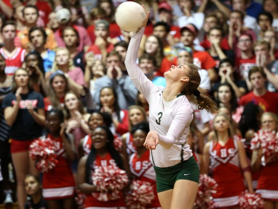 Lincoln's Amber Grant serves the ball against Leon