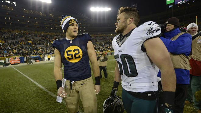 Green Bay Packers linebacker Clay Matthews (52) visits with his younger brother, Philadelphia Eagles linebacker Casey Matthews, after the Nov. 16 game at Lambeau Field. The Packers defeated the Eagles 53-20.