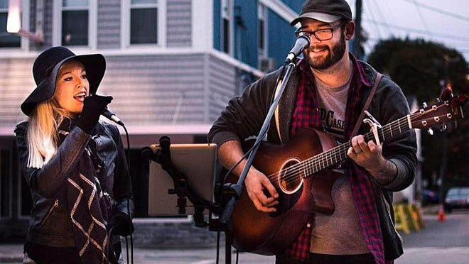 Destiny DeCasper, left, and Tom DeCasper, of Maybelle & the Band, are shown at a previous performance. They are among the Erie-area musicians using the internet to share their performances during the 2020 coronavirus pandemic.