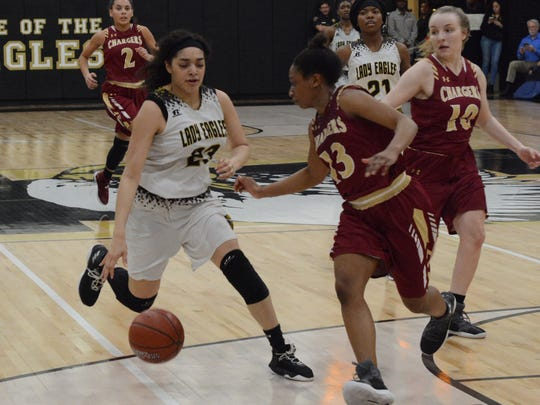 Abilene HIgh's Destiny Gallentine tries to get around Keller Central's Alaina Antwine (13) during the Lady Eagles' 57-49 win Friday at Eagle Gym.