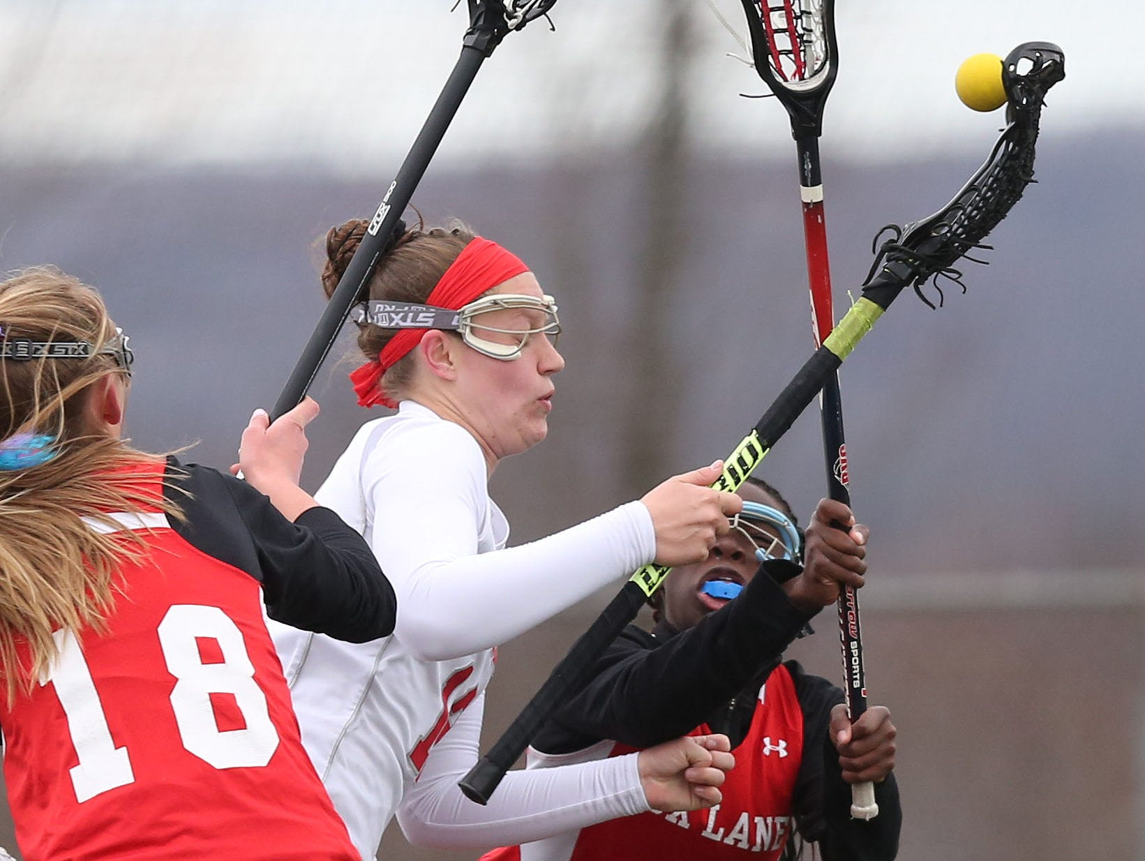 Somers' Livy Rosenzweig (12) drives to the goal in front of Fox Lane's Alison Moky (2) during a girls lacrosse game at Somers High School April 8, 2016. Somers won the game 15-12.