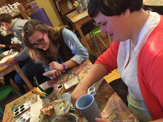 NexGen Door County holds monthly gatherings for young professionals around the county.  Pictured are Nea Kettering, right, and Emily Hanley, left, taking part in a NexGen pottery painting event.
