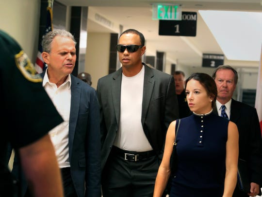 Tiger Woods, center, leaves the North County Courthouse