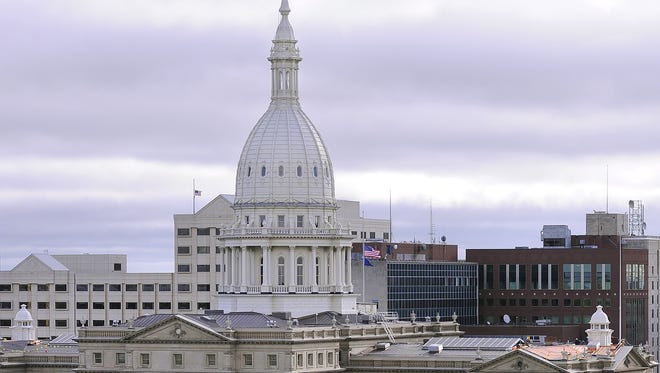 The state Capitol building, Boji Tower and other buildings  in downtown  Lansing are seen in this September 2014 LSJ file photo.