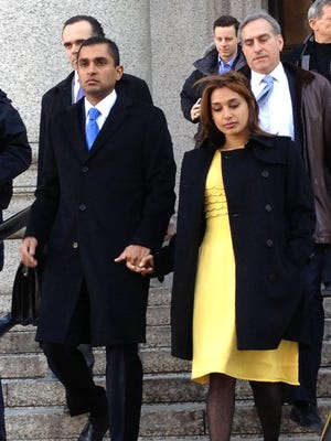 Mathew Martoma, left, leaves federal court in New York City with his wife, Rosemary, Thursday after his Feb. 2014 insider-trading conviction.