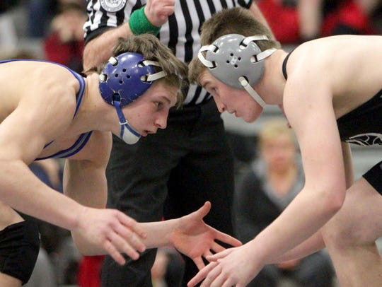 Plymouth's Ethan Shulaw (right), shown wrestling against