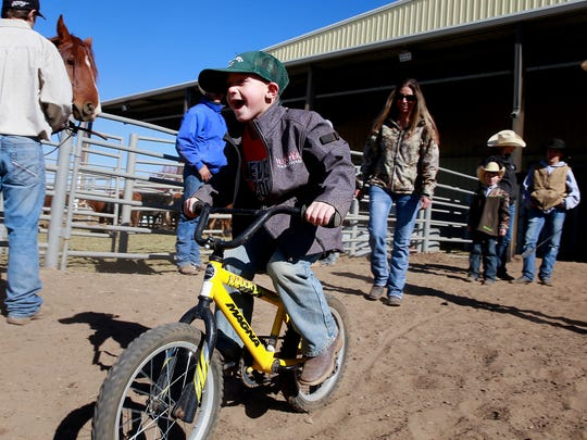 Payson Loya, 7, of Blanco takes off on his bicycle