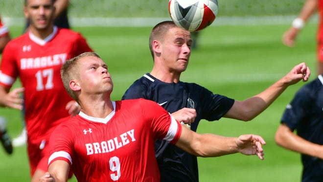 Bradley's Gerit Wintermeyer (9) battles Oral Roberts Blake Perott during a soccer matchup in 2018.