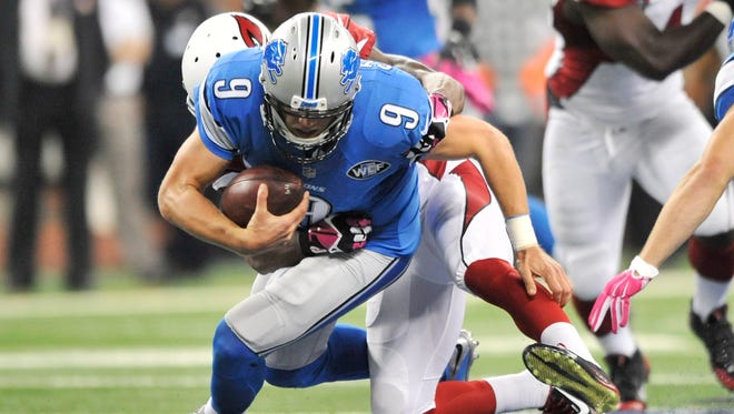 Matthew Stafford is sacked in the second quarter Sunday.