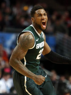 Mar 15, 2015; Michigan State Spartans guard/forward Branden Dawson (22) reacts as he heads into a timeout against the Wisconsin Badgers during the second half in the championship game of the Big Ten Tournament at United Center.