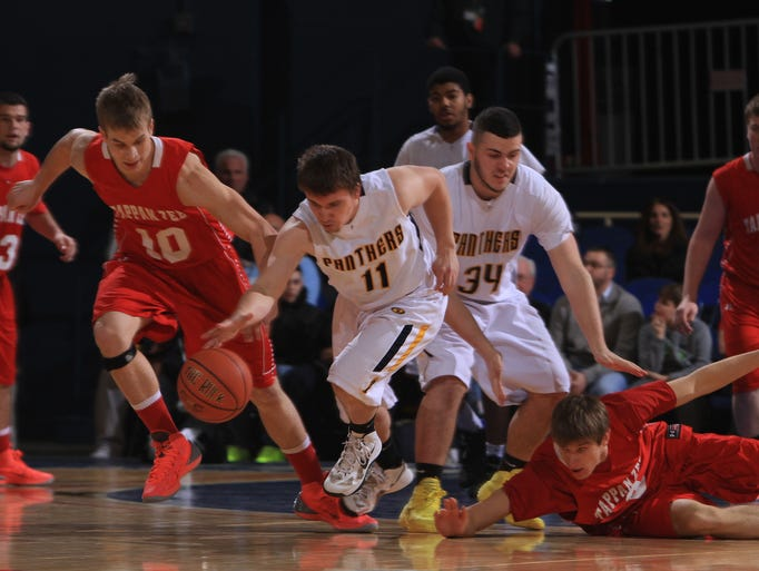 Walter Panas' Thomas Parish (11) comes away with a loose ball in front of Tappan Zee's Ryan McWilliams (10) during the Class A boys basketball semifinal game at the Westchester County Center in White Plains Feb. 26, 2014. Panas won 39-38.