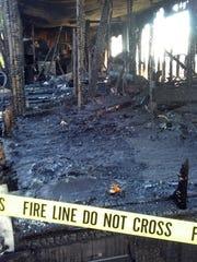 A burned home west of Harrisonburg, a single-wide trailer