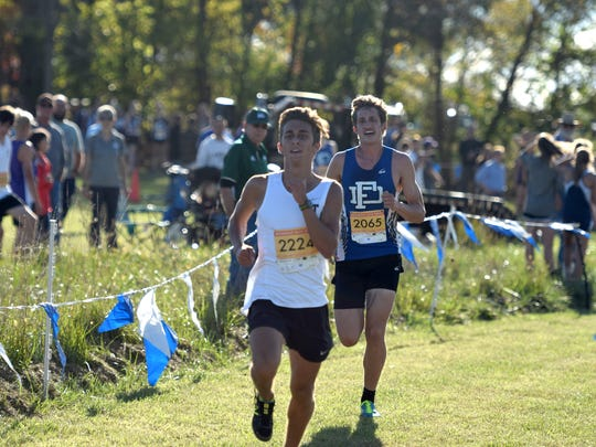 Fort Defiance's Jacob Jones, right, keeps up with Turner Ashby's Seth Dye as they head for the finish line during the boys race at the VHSL Valley District Cross Country Championships at Shamrock Farms in Verona, Va., on Tuesday, Oct. 24, 2017.