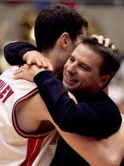 Iowa State coach Larry Eustachy hugs Paul Shirley (45) in the closing seconds of the Cyclones' Big 12 title game win after defeating Nebraska on Saturday, March 3, 2001.