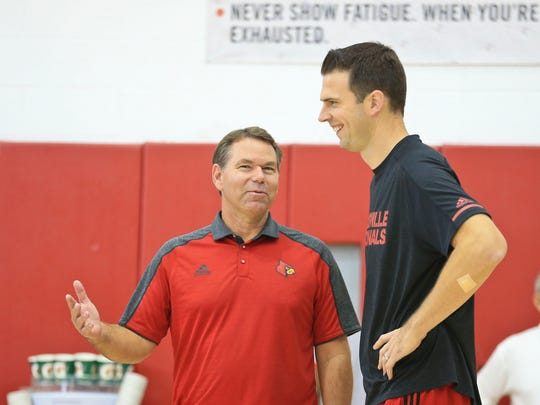 Louisville interim coach David Padgett laughs with interim athletic director Vince Tyra.