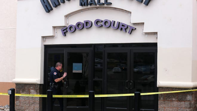Farmington Police Cpl. Jared Stock enters the Animas Valley Mall in Farmington on Saturday after a bomb threat was discovered in a women's restroom.