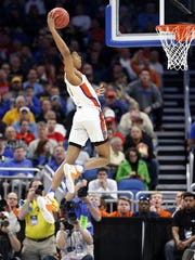 Florida forward Devin Robinson soars high to dunk during the first half of a first-round men's college basketball game against East Tennessee State in the NCAA Tournament, Thursday, March 16, 2017, in Orlando, Fla. (AP Photo/Wilfredo Lee)