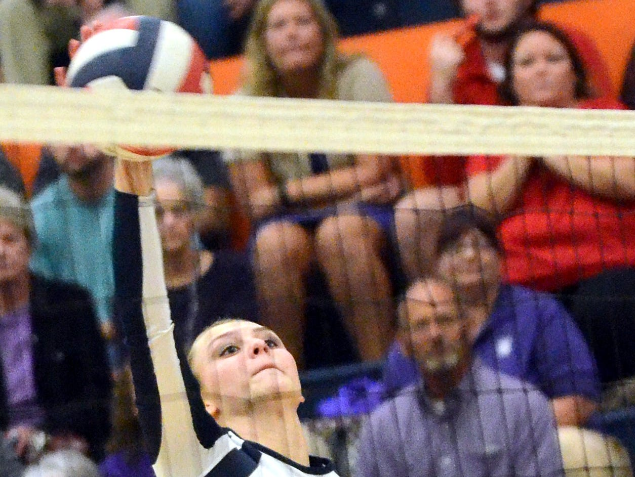 Beech High senior outside hitter Riley Sperlich swings into a set during the second game.