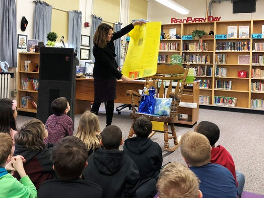 Before the Fountain City Elementary third-graders returned to their classroom, they presented first lady Crissy Haslam with a Pep Cat tumbler and a handmade poster.