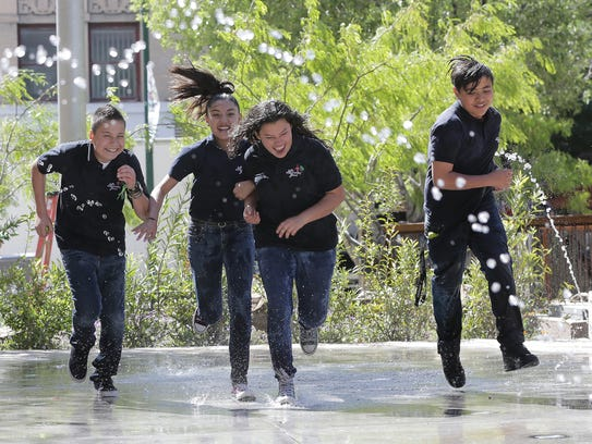 Students from La Fe Preparatory School play in the