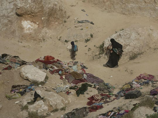 A woman and her children, who left the besieged Islamic