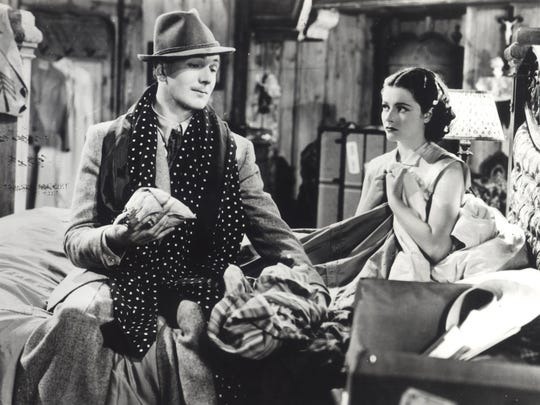 "Michael Redgrave and Margaret Lockwood get acquainted in Alfred Hitchcock's ""The Lady Vanishes."""