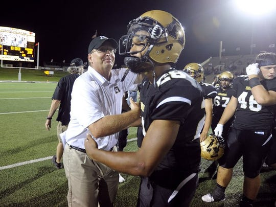 Thomas Metthe/Reporter-News Abilene High head coach Del Van Cox congratulates running back Abram Smith (28) after being names player of the game following the Eagles' 55-38 win over Cooper in the crosstown football game on Friday, Sept. 9, 2016, at Shotwell Stadium.