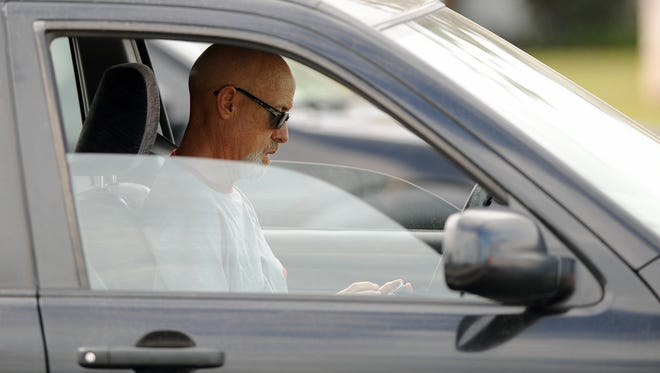 A driver using his cellphone while driving near Pacific Coast Highway in Long Beach.