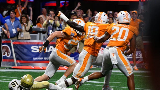 Tennessee defensive lineman Darrell Taylor (19) and teammates celebrate after leaving Georgia Tech quarterback TaQuon Marshall (16) on the ground and winning the Chick-fil-A Kickoff Game Monday, Sep. 4, 2017 42-41 in Atlanta, Ga.