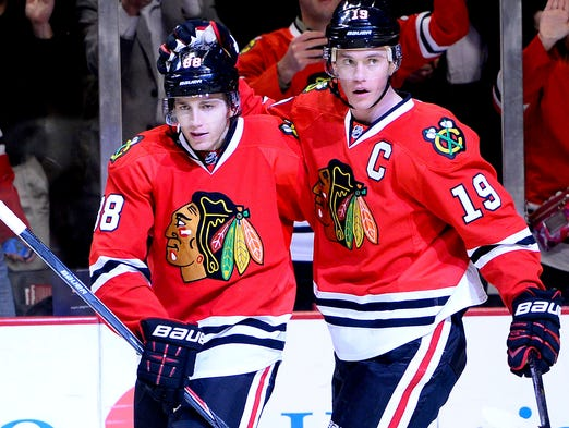 Chicago Blackhawks forwards Patrick Kane, left, and Jonathan Toews agreed to eight-year, $84 million extensions on July 9. NHL contracts totaling more than $70 million.