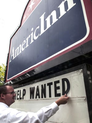 AmericInn general manager Nick Trahair has two summer job openings. Other northern lower peninsula employers need far more staff.