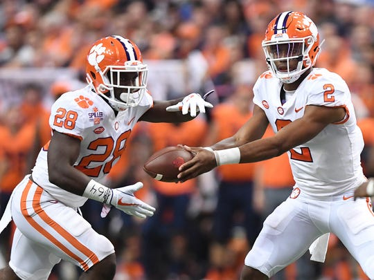 Clemson quarterback Kelly Bryant (2) hands off to running back Tavien Feaster (28) during the 1st quarter on Friday, Oct. 13, 2017 at the Carrier Dome in Syracuse, N.Y.