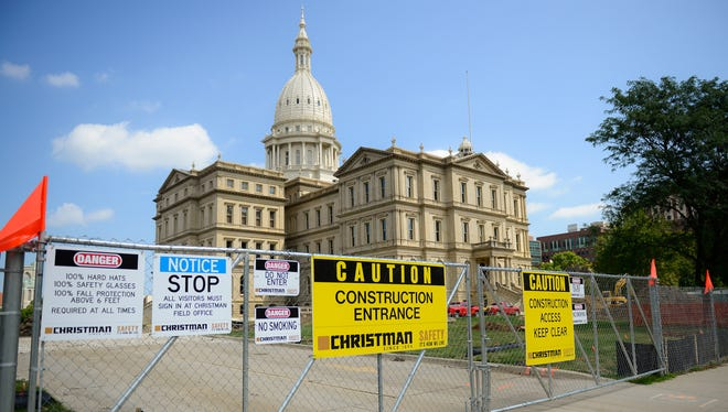Signs warn passersby of work on the southwest side of the state Capitol on Wednesday, Aug. 16, 2017. Workers are preparing for construction of a geothermal system and underground central utility plant.  ]