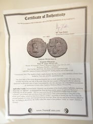 A certificate of authenticity from one of the coins